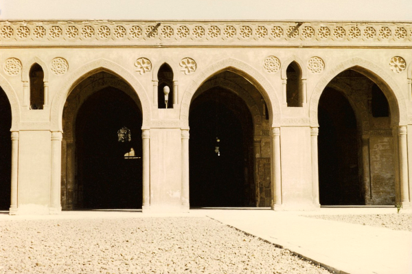 View of the riwaq from the courtyard showing the beautifully carved stucco
