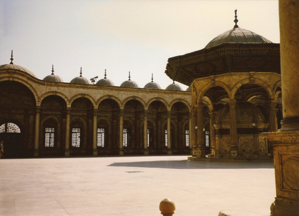 The sahn with the ablution fountain and riwaq in background
