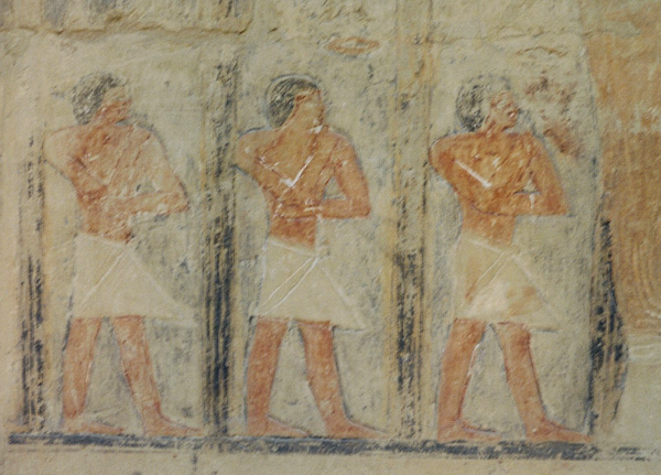 Attendants on the west wall of the four-pillar room