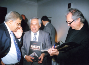 Jean-Pierre Houdin signs copies of his first book about The Great Pyramid for Magdy El-Ghandour, Director for the foreign missions at the Supreme Council of Atiquities and Taha Abdallah, Dean of Shorouk University.  (Photo courtesy of Jean-Pierre Houdin)