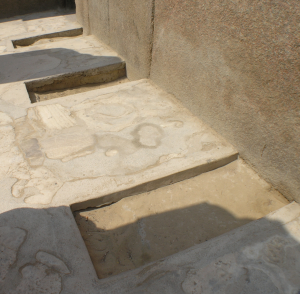 Indentation in the alabaster floor of the Sphinx Temple where cult statues would have once stood (Photo by Daniel Mayer)