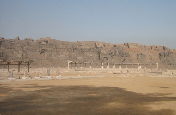 Looking west across the north quarry at the First Intermediate Period enclosure wall (Photo by Girolame)