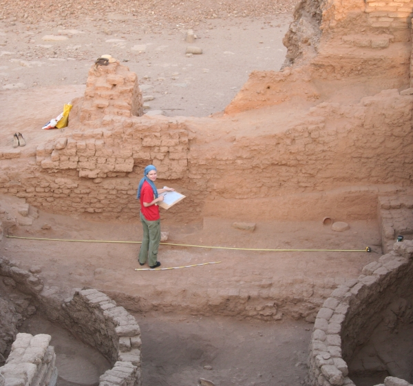 Dr. Moeller with some of the grain silos of Tell Edfu (Photo by Gregory Marouard, Tell Edfu Project)