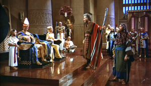 Charlton Heston as Moses and Yule Brenner as Ramesses II