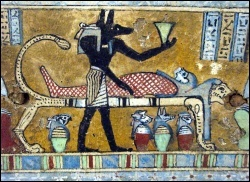 Anubis overseeing a mummification