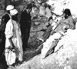 Abd el-Rassul (in white on the left) with Gaston Maspero (on right, reclining) at the entrance to DB320