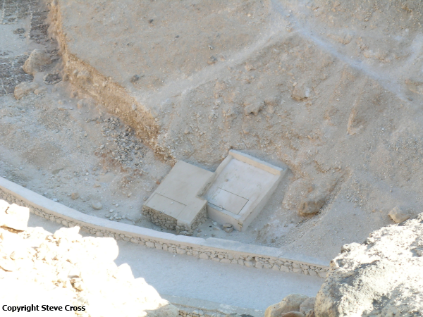 The newly-discovered tomb KV64 (left) next to KV40. KV64 was discovered during routine clearing of debris by a team from the University of Basel in their work to document uninscribed tombs in the Valley of the Kings (photo by Steve Cross)