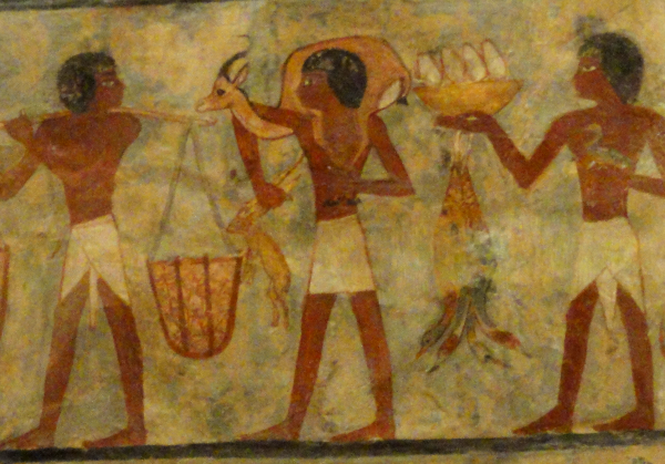 Detail from the tomb of Metchetchi of offering bearers. Similar processions would have been filing into the temple for any major feast (Photo by Keith Payne, from the Louvre)