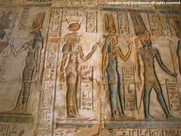 The Ptolemaic Hathor temple at Deir el Medina. From the central chapel that was dedicated by Ptolemy IV to Hathor. In the photo is (from the right) Amun, Ma'at and Hathor. During the Ptolemaic period most of the goddesses were depicted with horns like Hathor has. (Photo Heidi Kontkanen, April 2011)