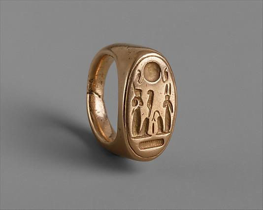 Finger Ring of King Akhenaten and Queen Nefertiti (as Shu and Tefnut) found in el-Amarna (Akhetaten); inc. el-Hagg Qandil, Town, Petrie 1891-1892 Medium: Gold Dimensions: diam. 2.5 cm (1 in); l. of bezel 2.3 cm (7/8 in) Metropolitan Museum of Art Accession Number: 26.7.767 (Yvonne, contrib.)