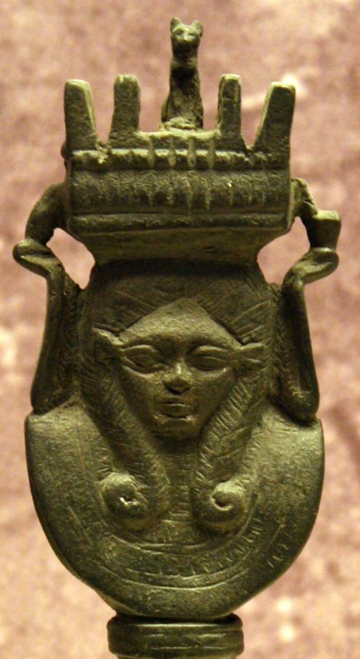 Fragmentary copper alloy temple-shaped sistrum. A cat, symbol of the goddess Hathor, is depicted before the temple's entrance.  Late Period. National Archaeological Museum of Athens, 687.  (Merja Attia, contrib.)