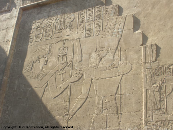 The king receives a heb-sed symbol from god Amun.  The symbol represents the festival.  The relief can be found at the outer wall of the Temple of Osiris-Heqadjet at Karnak  (Photo by Heidi Kontkanen)