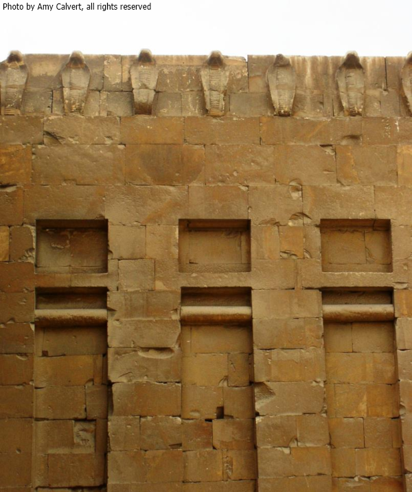 Uraeus frieze in the southwest corner of the courtyard of Djoser's complex (Photo by Amy Calvert)