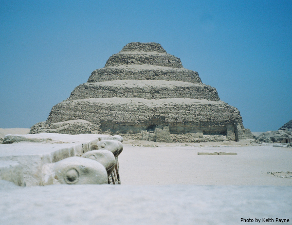 Looking north over the heads of the cobra frieze to the Step Pyramid, the territorial markers can be seen in the South Court (Photo by Keith Payne, 1997)