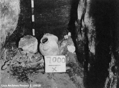 Offerings placed in the niche of Hetepheres' tomb, looking west after removing the blocking masonry (Giza Archives Project C 10918)