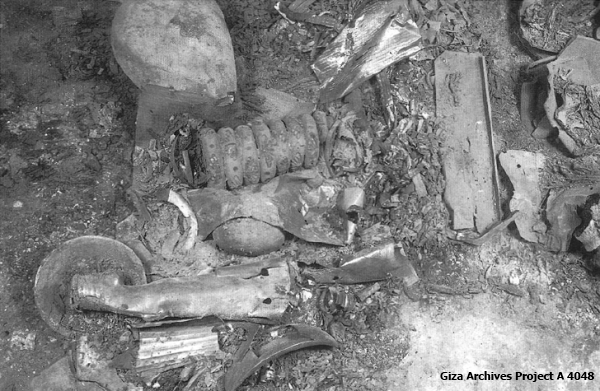 Queen Hetepheres' scattered grave goods as discovered.  The butterfly bracelets can be discerned toward the center of the photo (Giza Archives Project A 4048)