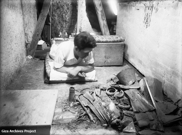 Reisner team member Noel F. Wheeler  on his belly, excavating the chamber of Queen Hetepheres on tiny scrap at a time, logging the location of each piece, July 22, 1926 (Giza Archives Project, Sarah Shepherd, contrib.)