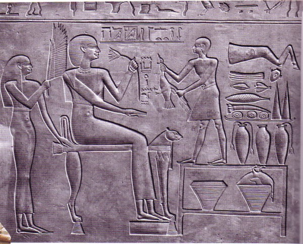 DDC Another queen of Montuhotep II - Ashayet. The scene is carved in the outside of her sarcophagus and a similar scene inside - the lotus blossom she is smelling was believed to have powers of rejuvenation.  From Deir el-Bahri (Jean Smith, contrib.)