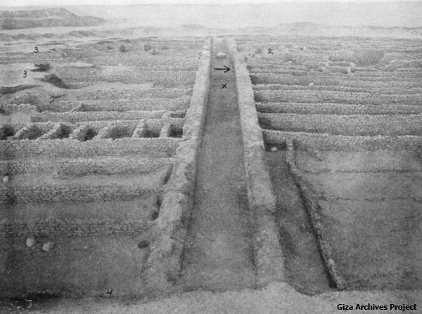 The tomb of Hepzafa, looking east through the Corridor of Sacrifices. The X marks where the statue of Sennuwi stood, the arrow marks the main burial chamber (Giza Archives Project)
