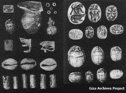 Glass bottle, amulets, beads and scarabs from Menkaure's Valley Temple (Giza Archives Project)