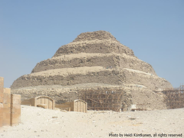 Restoration work on Djoser's pyramid in 2010, with workmen and their wheelbarrows visible on the pyramid clearing away debris (Photo by Heidi Kontkanen, 2010)
