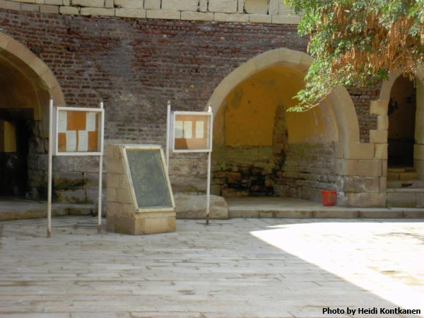 The replica of the Rosetta stone, between the message boards, at the courtyard of the Citadel at Rosetta or Fort Julien, where the Rosetta stone was found (Photo by Heidi Kontkanen, 2011)