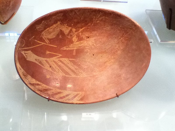 Bowl showing a man on a boat next to a hippo and a crocodile. Should this be interpreted as a hunting scene which actually is being commemorated or as a depiction of the proto-royal chieftain in his role as lord over nature? (Photo by Ashershow1)