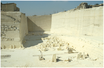 A modern Tura limestone quarry where blocks are still completely dressed (Source: Wikipedia Commons).