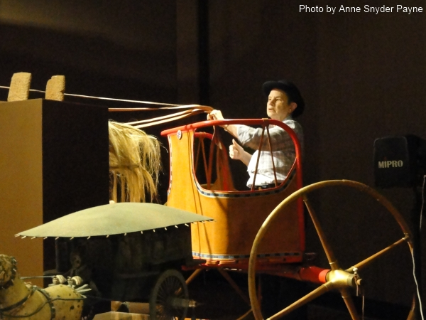 Kathy Hansen and the New Kingdom chariot she helped reconstruct at the International Museum of the Horse (Photo by Anne Snyder Payne)