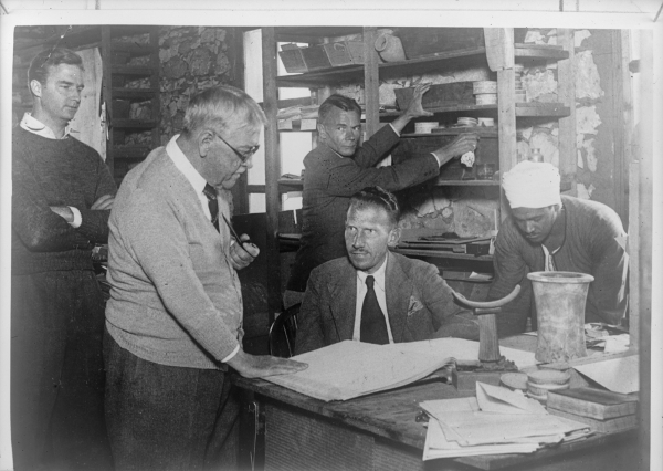 Harvard Camp, Giza offices; from left to right: Frank O. Allen, George Reisner, Nicholas Melnikoff, Hansmartin Handrick (seated), and Mohammed Said Ahmed (photograph from Al-Mussawar Arabic magazine, no. 740, December 16, 1938); January 4, 1939. Courtesy of Digital Giza: The Giza Project at Harvard University/Museum of Fine Arts Boston, photo ID HUMFA_B9021_NS.