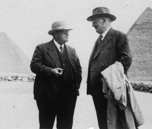 George Reisner and Georg Steindorff at Camp Harvard, looking east toward the pyramid of Khafre (foreground) and Khufu (background). Photo ID HUMFA_C13564_NS, photo and description courtesy of the Giza Archives maintained by Harvard University and the Museum of Fine Arts Boston, online at Digital Giza.