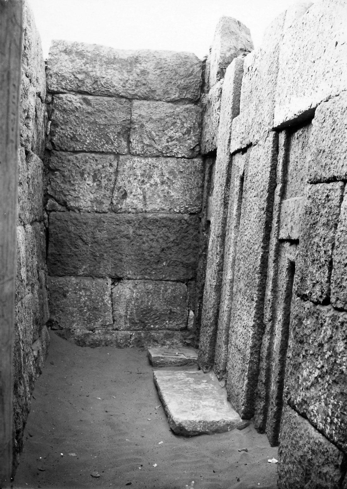 Mastaba of Inpuhetep, chapel, offering stone inscribed for Inpuhetep (Hildesheim RPM_3042) in situ in front of southern false door, looking south. Photo ID KHM_AEOS_II_2815, photo and description courtesy of the Giza Archives maintained by Harvard University and the Museum of Fine Arts Boston, online at Digital Giza.