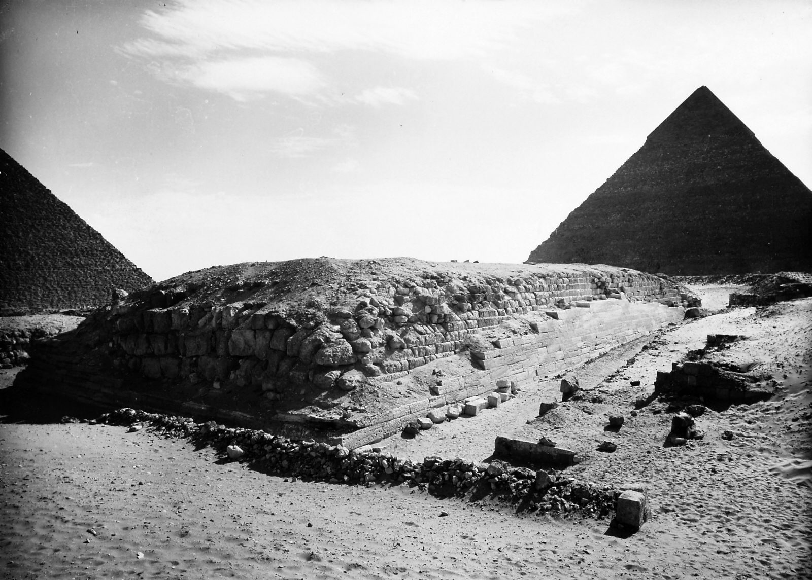Although Hemieunu's great mastaba (G 4000) dominates the photo (looking south-southeast), the northern end of Nisutnefer's D 59 can be seen in the foreground, right. Photo ID KHM_AEOS_II_5058, photo and description courtesy of the Giza Archives maintained by Harvard University and the Museum of Fine Arts Boston, online at Digital Giza.