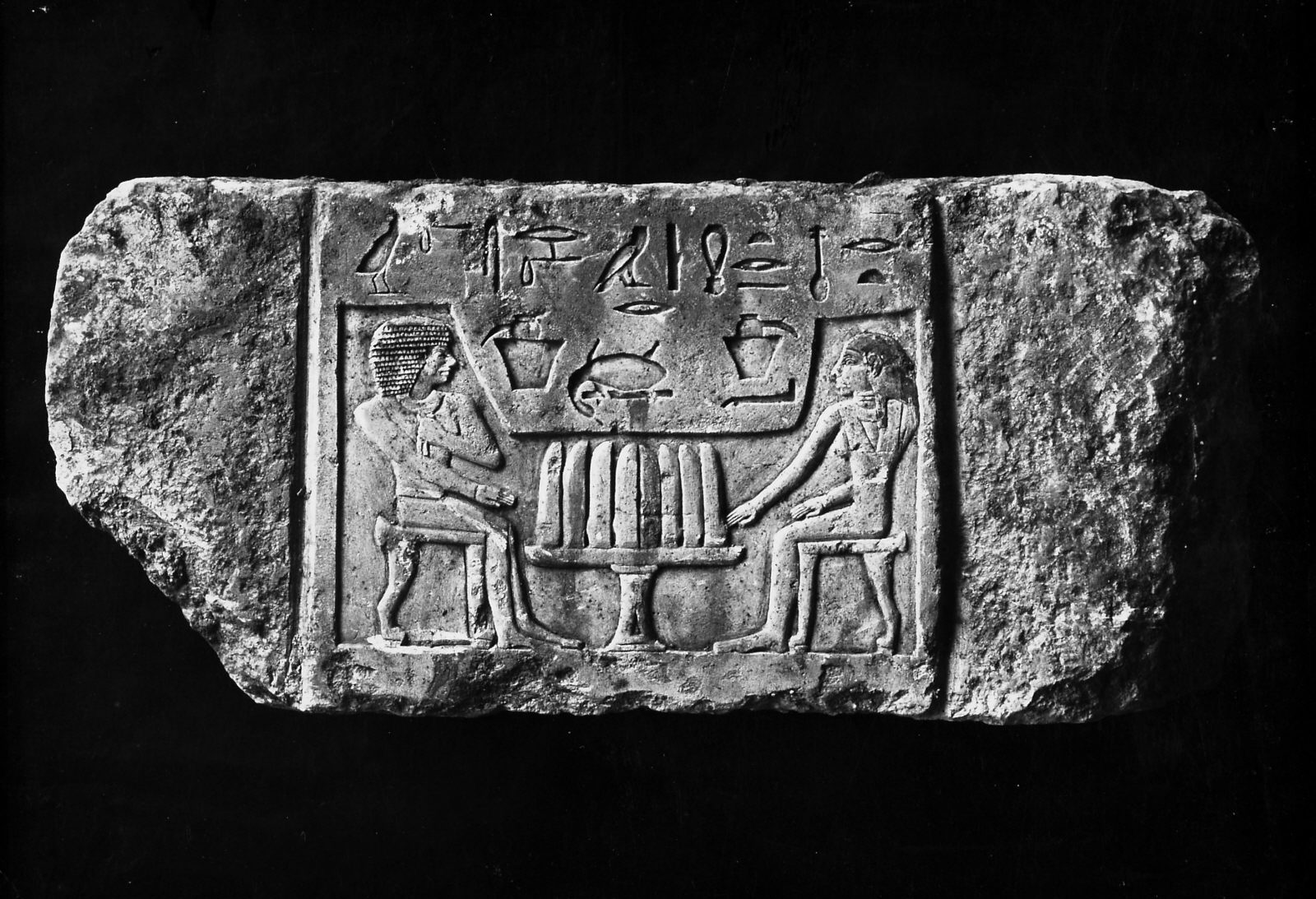 False door tablet (depicting Seshemu and his wife Nefret seated at offering table) from D 116, shaft S 2163, currently in the Pelizaeus-Museum, Hildesheim (acc. no. 3044). Photo ID KHM_AEOS_II_2781, photo and description courtesy of the Giza Archives maintained by Harvard University and the Museum of Fine Arts Boston, online at Digital Giza.