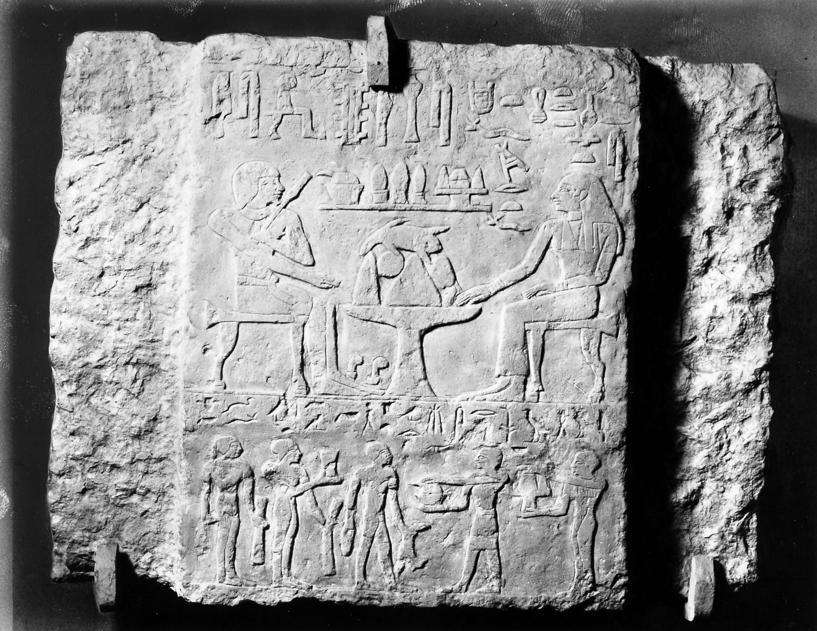 False door tablet inscribed for Shepsi from mastaba of Shepsi, northern false door (Shepsi and his wife Neferwates seated at offering table, and his children below: Djefaibka, Kaemmerut, Werkaptah, Suk, Hui), currently in Kunsthistorisches Museum, Vienna (ÄS 8519). Photo ID KHM_o_neg_nr_0195, photo and description courtesy of the Giza Archives maintained by Harvard University and the Museum of Fine Arts Boston, online at Digital Giza.