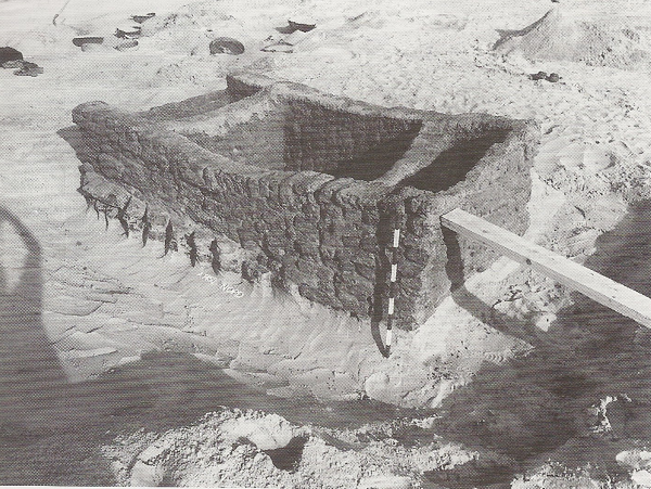 A Predynastic tomb at Minshate Abu Omar, excavated to reveal the crude brick lined substructure. Adams and Cialowicz, p. 20.