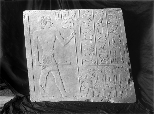 Block of relief (standing figure of Nefer, inscription, and four scribes identified as Nefru, Weni, Khentikauf, Senenuka) from northern door jamb from G 2110, [GLYPHS] Nefer. Currently in the Museum of Fine Arts Boston, acc. no. MFA 07.1002. Photo ID HUMFA_A93_NS, photo and description courtesy of the Giza Archives maintained by Harvard University and the Museum of Fine Arts Boston, online at Digital Giza.