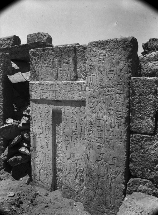 G 2366 (abutting eastern face of G 2360), false door inscribed for Nimesti (wife Kamerites and two sons Neferkhent and Irenakhet also appear on false door), looking southwest. Photo ID HUMFA_A5778_NS, photo and description courtesy of the Giza Archives maintained by Harvard University and the Museum of Fine Arts Boston, online at Digital Giza.