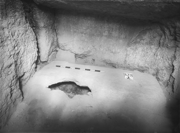 G 2375 A, burial chamber, hole in lid over rock-cut pit-coffin, looking west. Photo ID HUMFA_A7302_NS, photo and description courtesy of the Giza Archives maintained by Harvard University and the Museum of Fine Arts Boston, online at Digital Giza.